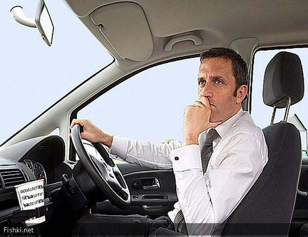 Мужчина за рулем автомобиля фото